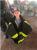 Child Dressed in Firefighter Gear