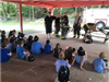 Children Sitting and Listening to Firefighters
